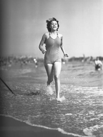 Woman in Swimsuit Running on Shoreline-George Marks-Photographic Print