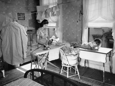 Woman Ironing in Slum Home-William C^ Shrout-Photographic Print