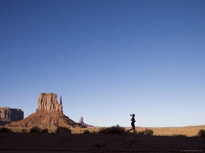 Woman Jogging, Monument Valley Navajo Tribal Park, Utah Arizona Border, USA-Angelo Cavalli-Photographic Print