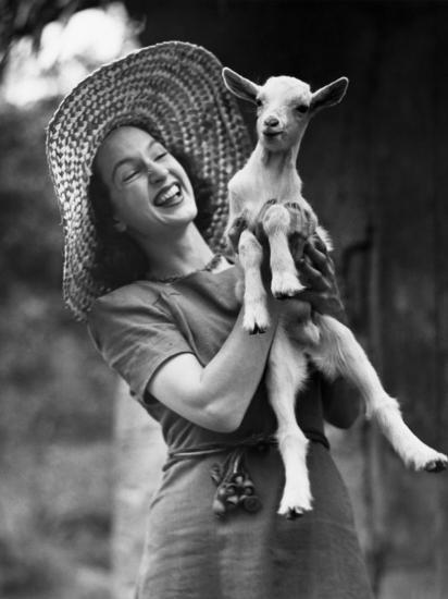 Woman Laughing and Holding a Goat-George Marks-Photographic Print