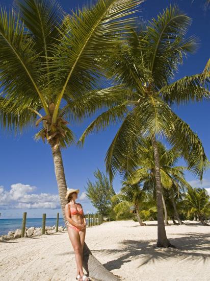 Woman Leaning Against Palm Tree, Princess Cays, Eleuthera Island, West Indies, Caribbean-Richard Cummins-Photographic Print