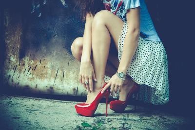 Woman Legs In Red High Heel Shoes And Short Skirt Outdoor Shot Against Old Metal Door-coka-Art Print