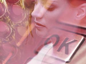 Woman Looking at Lipstick