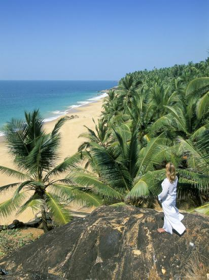 Woman Looking Over Coconut Palms to the Beach, Kovalam, Kerala State, India-Gavin Hellier-Photographic Print