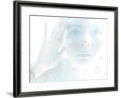 Woman Looking Through a Window with Etched Snow Flake Symbols--Framed Photographic Print