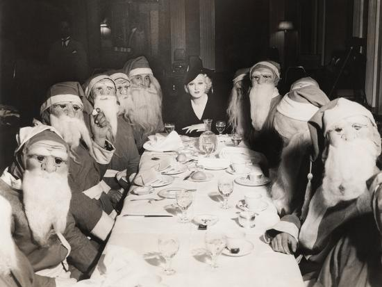 Woman Lunching with Twelve Santa Clauses--Photo