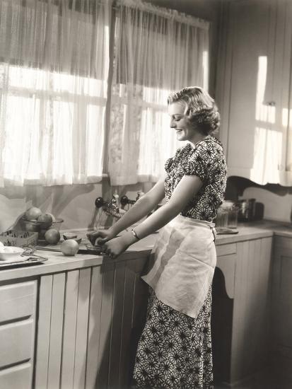 Woman Making Homemade Orange Juice--Photo