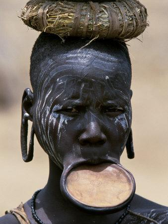 https://imgc.artprintimages.com/img/print/woman-of-the-mursi-tribe-her-clay-lip-plate-shows-that-she-is-married-ethiopia_u-l-p8xwcx0.jpg?p=0