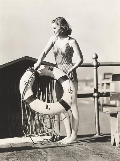 Woman on Pier Holding a Life Preserver-Everett Collection-Photographic Print