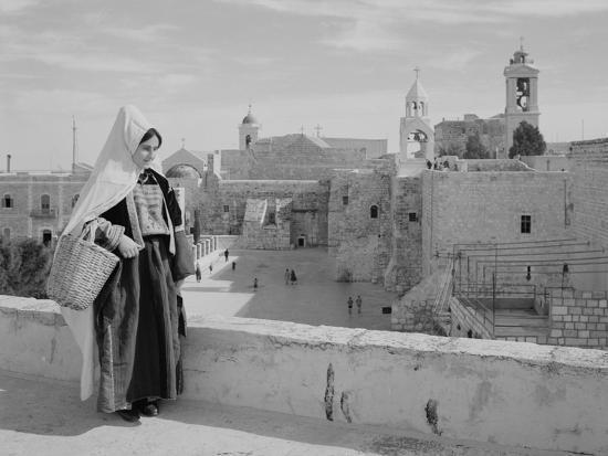 Woman on Roof Facing Church of the Nativity Photograph - Bethlehem, Palestine-Lantern Press-Art Print