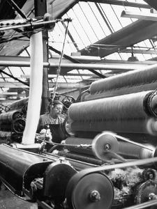 Woman Operating Carding Machine at Wool Mill