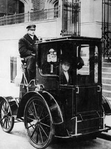 Woman Passenger in a 1910 Taxi Cab, New York, USA, C1910