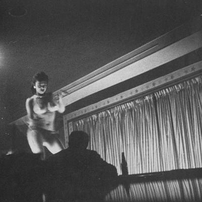 Woman Performing a Strip Tease Dance--Photographic Print