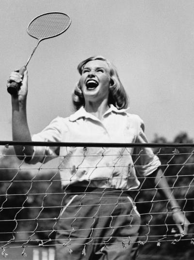 Woman Playing Badminton--Photographic Print