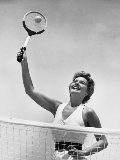 Woman Playing Tennis--Photographic Print