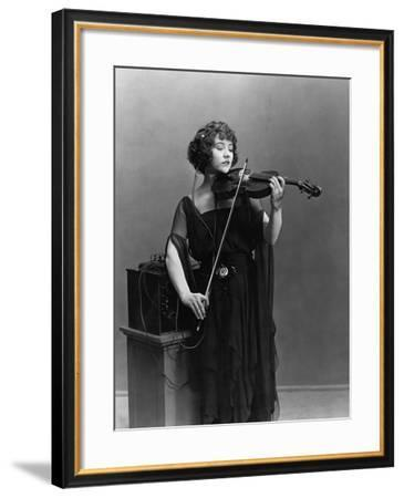 Woman Playing Violin with Headphones--Framed Photo