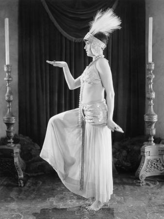 https://imgc.artprintimages.com/img/print/woman-posing-in-a-exotic-dress_u-l-q1bwvqj0.jpg?p=0