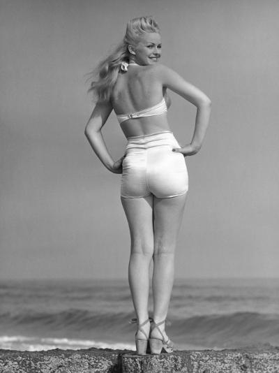 Woman Posing on the Beach in Bathing Suit-George Marks-Photographic Print