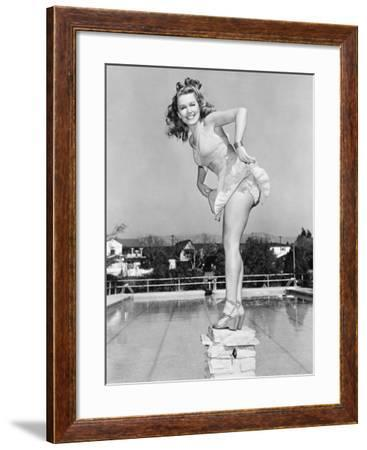Woman Posing on Top of a Pillar Next to a Swimming Pool--Framed Photo