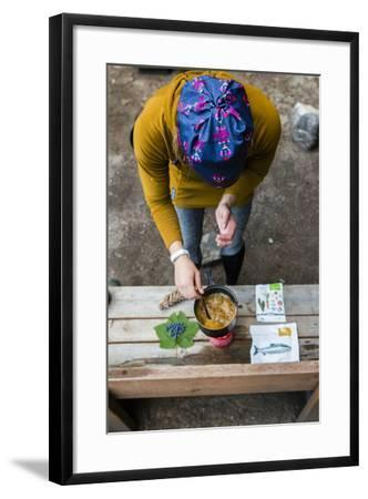 Woman Prepares Her Dinner At Her Camp Site In The Backcountry-Hannah Dewey-Framed Photographic Print