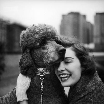 Woman Profiling a Big Smile While Adoring Her Poodle Wearing Large Swiss Watch on Dog Collar-Yale Joel-Photographic Print