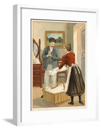 Woman Putting Neatly Folded Shirts into a Basket--Framed Giclee Print