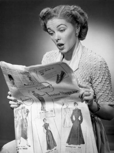Woman Reading Newspaper With Look of Surprise-George Marks-Photographic Print