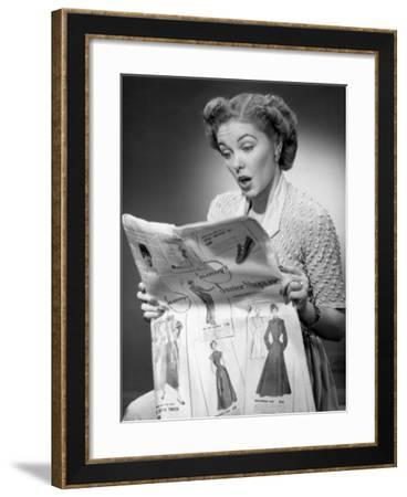 Woman Reading Newspaper With Look of Surprise-George Marks-Framed Photographic Print