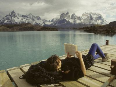 https://imgc.artprintimages.com/img/print/woman-relaxes-on-a-dock-while-reading-a-book_u-l-p8h1gw0.jpg?p=0