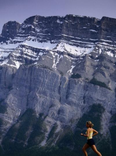 Woman Running in Front of Mountain, Banff, Canada-Woods Wheatcroft-Photographic Print