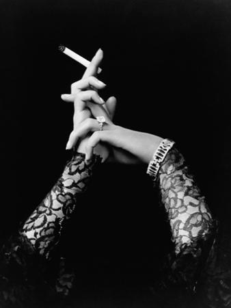 Woman's Hands Holding Cigarette