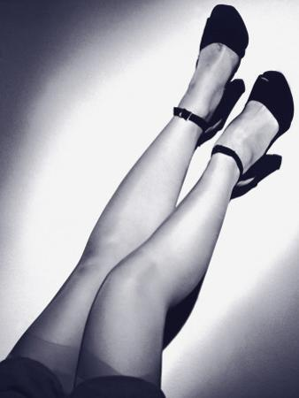 Woman's Legs, in Stockings and Shoes With Ankle Straps
