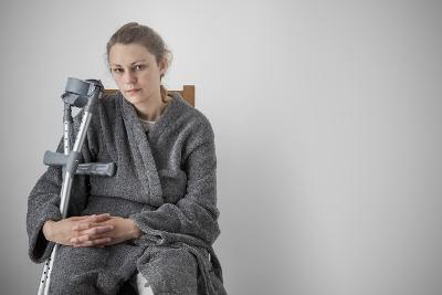 Woman Seated with Crutches-Anthony West-Photographic Print