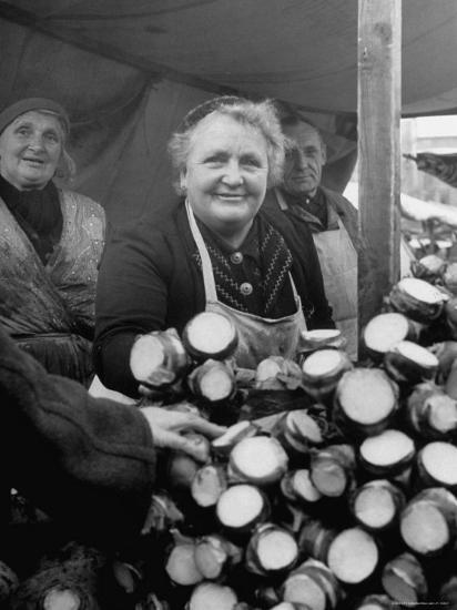 Woman Selling Vegetables at an Open Air Market Stall-Nina Leen-Photographic Print