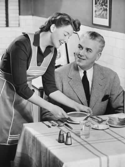 Woman Serving Soup To Husband-George Marks-Photographic Print