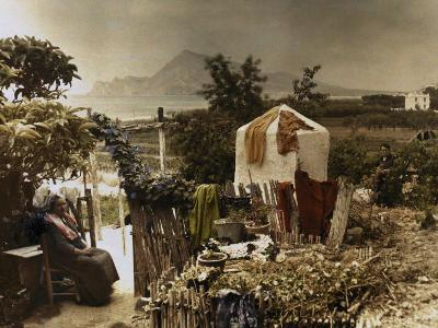 Woman Sits in Her Garden in Altea-Gervais Courtellemont-Photographic Print