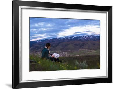 Woman Sits On Top Of A Hill Sketching-Hannah Dewey-Framed Photographic Print
