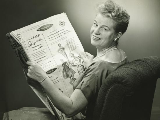 Woman Sitting in Armchair, Reading Newspaper, Smiling-George Marks-Photographic Print