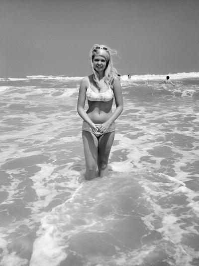 Woman Standing in Ocean Surf-Philip Gendreau-Photographic Print