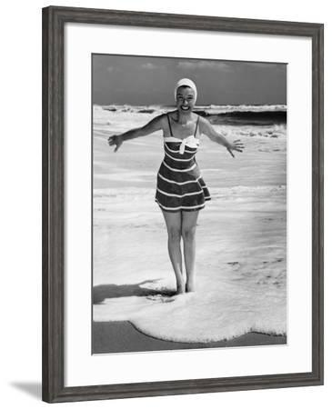 Woman Standing in Shallow Water at Ocean--Framed Photographic Print