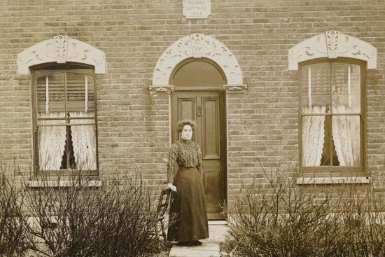 Woman Standing Outside Reuben Cottage--Photographic Print