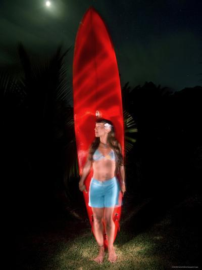 Woman Stands by a Big Wave Surf Board under a Full Moon, Hawaii-Bill Hatcher-Photographic Print