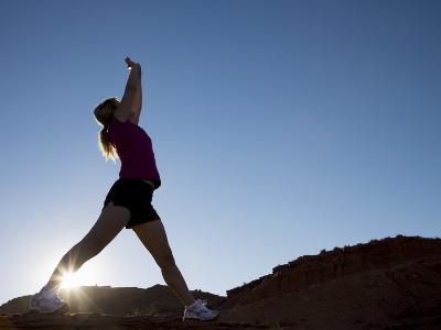 Woman Stretching, Monument Valley Navajo Tribal Park, Arizona Utah Border-Angelo Cavalli-Photographic Print