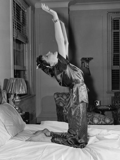 Woman Stretching on Bed--Photo