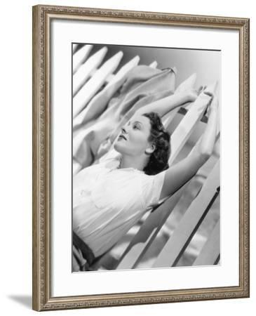 Woman Stretching Out on a Picket Fence--Framed Photo