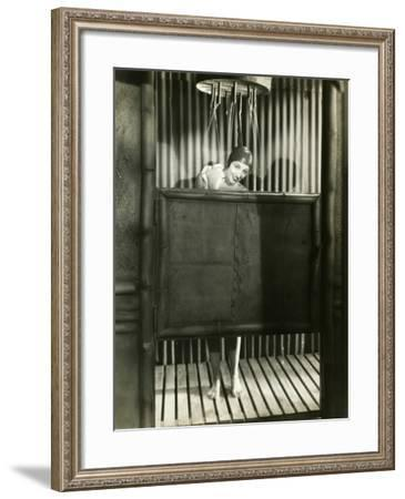 Woman Takes a Shower in a Bathing Cap--Framed Photo