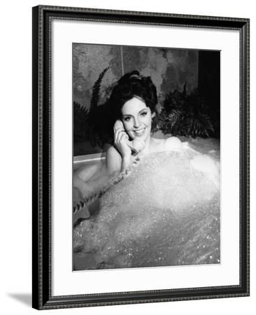 Woman Talking on Phone in Bubble Bath--Framed Photo