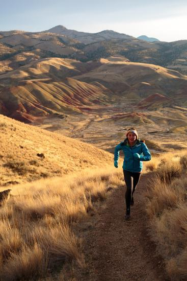 Woman Trail Runs Scenic 3/4 Mile Carroll Rim Trail Painted Hills, John Day Fossil Beds NM, Oregon-Ben Herndon-Photographic Print
