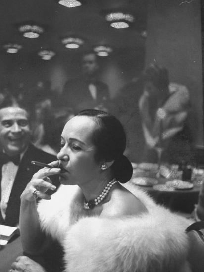 Woman Tries Lady's Cigar in Club After Release of Surgeon General's Report on Smoking Hazards-Ralph Morse-Photographic Print