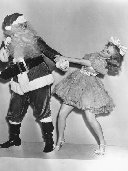 Woman Trying to Dance with Santa Claus--Photo